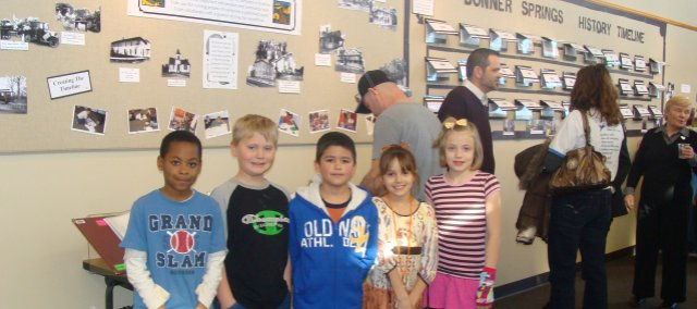 Larry Fox, Caleb Lewis, Omar Gonzalez, Sammi Trumbo and Emily Ashford (from left) were among the Bonner Springs Elementary School third graders who showed off the historical timeline they created Sunday at the Bonner Springs City Library.