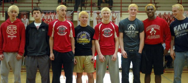 Eight THS wrestlers will be in action Friday when the Class 4A state championships begin in Salina. Pictured, from left, are Dalton Tavis, Clayton Himpel, Caleb Himpel, Joe Wolf, Asher Huseman, Matt Soetaert, Julius Coats and Thomas Miller.