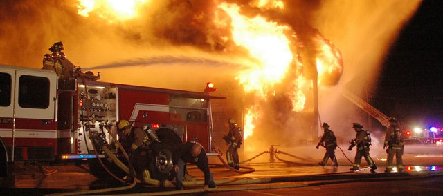 Firefighters battle a massive fire  fueled by high winds  at the Hampton Woods apartment complex, near 67th Street and Renner Road. The fire was reported about 7:15 p.m. Thursday. Shawnee Fire Chief John Mattox said everyone got out of the building safely, but its only getting worse with this wind. At 9 p.m., firefighters continued to pump water on a neighboring building to prevent it from catching fire, too. Jared Thornburg, who lives in the second building, came outside when the fire was reported. It was a tiny, little fire in the bottom apartment over there, he said.  and it went up.