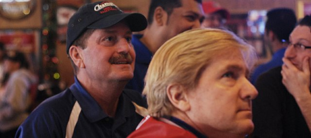 Pat Gilliam, Shawnee, and Rick Reichmeier, Overland Park, watch the beginning of what may be the final Border War basketball game between Kansas University and Missouri Saturday at Johnny's Tavern in Shawnee. The lifelong friends graduated from KU in the early 1980s and said they were sad to see the rivalry end.