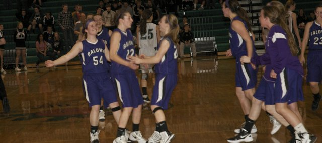 Baldwin girls celebrate their 30-29 victory in first-round sub-state play Monday at De Soto. With the win, the girls will play Ottawa at 7:30 p.m. Thursday at Baldwin.
