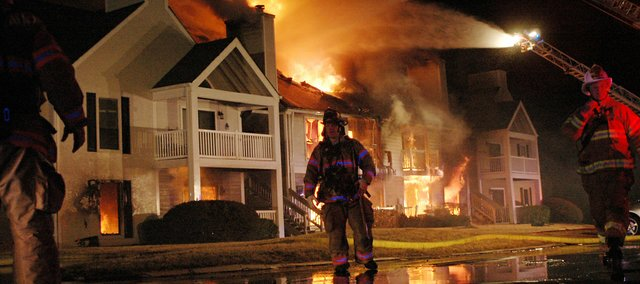 Firefighters battle a large fire — fueled by high winds — at the Hampton Woods apartment complex, near 67th Street and Renner Road. The fire was reported about 7:15 p.m. Thursday. Firefighters believe everyone got out of the building safely.