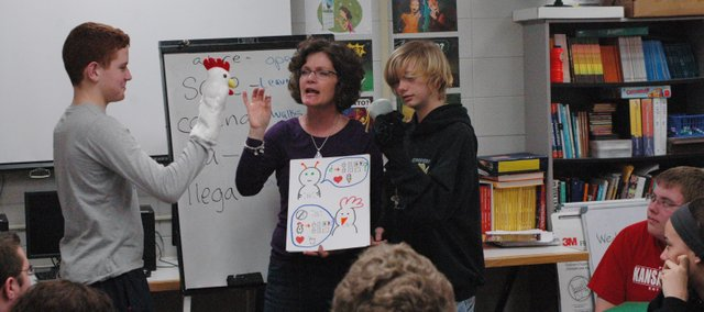 Susan Swabb (center) leads her third-hour Spanish 1 students through a story with the help of student puppeteers Logan Shearer (left) and Dylan Stagner as part of the classs new TPRS teaching method.