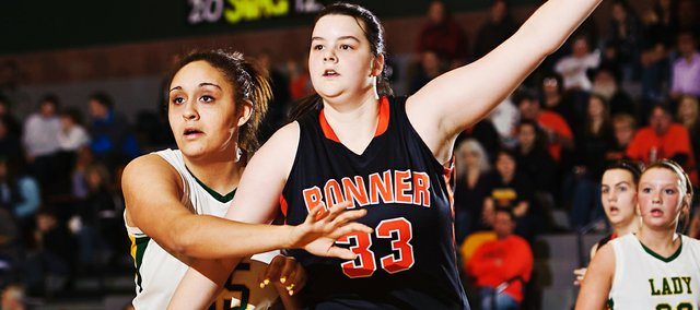 Bonner Springs senior Erica Wilson calls for the ball while being defended by Basehor-Linwood senior Bailey Hooker during the Braves' 44-24 victory on Feb. 24.