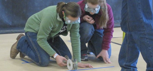 Basehor-Linwood Middle School seventh-graders Ashley Hoffman and Madison Bowers work with a mousetrap vehicle for Science Olympiad competition.