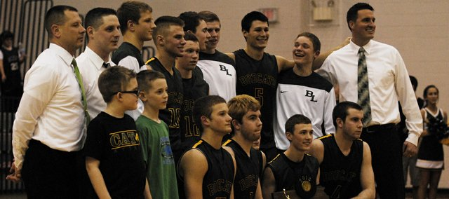 The Basehor-Linwood boys basketball team poses with its Class 4A sub-state trophy after defeating Topeka Hayden 58-51 on Saturday. The Bobcats relied heavily on senior Colin Murphy, who led the team with 24 points. Stay tuned for more coverage and photos, and find out who and when the Bobcats will play to begin the state tournament.