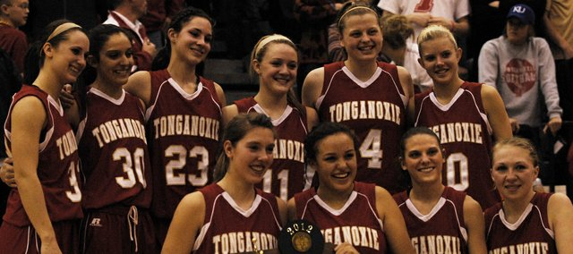 The Tonganoxie girls basketball team gathers around its Class 4A sub-state runners-up trophy on Saturday at Bonner Springs. The Chieftains lost, 58-50, in the championship game against No. 1-seed Bonner Springs. Junior Jenny Whitledge led the team with 12 points. Seniors Amanda Holroyd and Tavia Brown added nine and eight points, respectively. Sophomore Emma Stilgenbauer and junior Hannah Kemp each scored seven points. Stay tuned for a full recap and additional photos from the game.