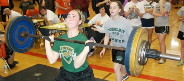 Courtney Leive breaks the 140-pound class state record with a 175-pound hang clean at the Class 4A state powerlifting tournament in Abilene on Saturday. The girls team won its fifth-straight state title and the boys won their third straight.