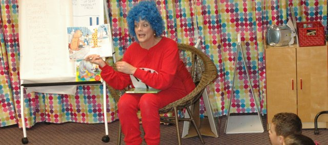 Jennifer Botteron, dressed as Thing 1, reads Friday to students at Bonner Springs Head Start.