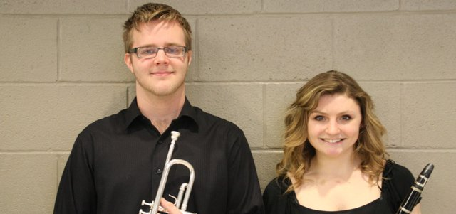 Basehor-Linwood High School student musicians Ben Forshee, junior, and Alex Bright, senior, hold their instruments. Both were selected for all-state bands last month.