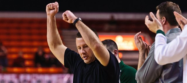 Basehor-Linwood coach Mike McBride celebrates during the Bobcats' 55-49 overtime victory against Pratt on Friday.