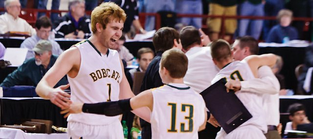 It's all over: The Bobcats react to winning the state title after they defeated Ottawa, 56-52 on Saturday in Salina.
