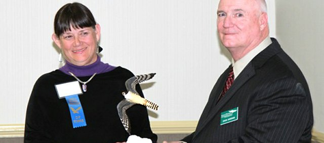 Kansas Riverkeeper Laura Calwell receives the 2011 Stream Monitor award from Don Snider, Kansas Wildlife Federation President. The Watershed Institute of Overland Park sponsored the award.