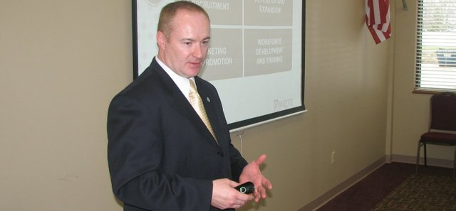Greg Kindle, president of the Wyandotte County Economic Development Council, speaks to members of the Basehor Chamber of Commerce on Thursday at Reece & Nichols in Basehor.