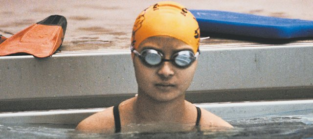 Scintilla Capalla, a Bonner Springs senior diagnosed with bone cancer last year, began practicing with the Braves' girls swimming team while she was still wrapping up chemotherapy.