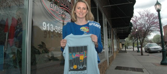 Kansas University alum Sarah Breuer is superstitious when it comes to KU basketball. The owner of The Downtown Drugstore in Tonganoxie has been known to wear multiple shirts during the course of a KU game depending on how the Jayhawks are faring.