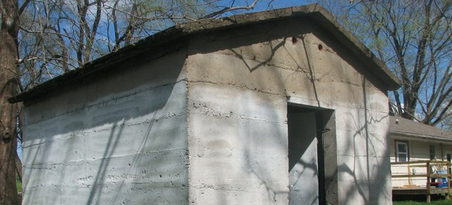 This concrete building, sitting in the backyard of a home on Leavenworth Road just east of 155th Street in Basehor, was built more than 100 years ago by Reuben Basehor, the citys founder, to serve as the young towns first library. Basehor Intermediate School third-graders visit the small, windowless structure each year as part of a historical tour. 
