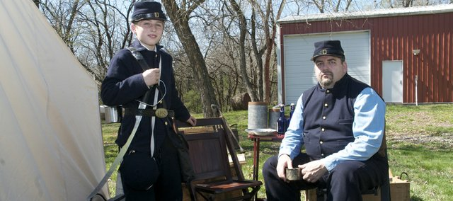 Sixth-grader Ryan Todd and his father Mike Todd model their new replica Union Civil War uniforms they will wear to a re-enactment this weekend at the Shiloh Battlefield in Tennessee. Ryan has planned his own re-enactment that he hopes will increase Civil War interest among fellow students