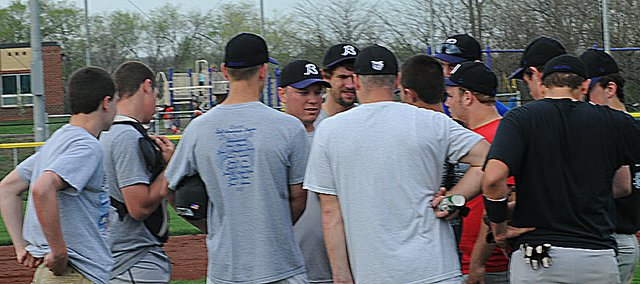 Baldwin High School baseball coach Brian Turk, fourth from left, talks to his team Tuesday during drills. The team will open its season at home with a doubleheader against Frontier League foe De Soto today. The first game will start at 4:30 p.m.