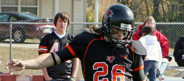Garrett Chumley, shown here punting for Baker University, played both offense and defense at Basehor-Linwood while impressing his coach with his punting power.
