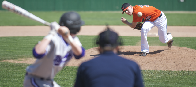 SM Northwest pitcher Marcus McNeace delivers a pitch to a hitter for Blue Springs on Saturday. The Cougars won, 9-7.