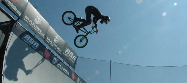 Professional BMX rider Jimmy Walker performs a stunt in September at Bonner Springs High School as part of the ASA High School Tour, an anti-tobacco initiative devoted to educating teens on the dangers of smoking. U.S. Surgeon General Regina Benjamin has released a new report calling on the country to make the next generation tobacco-free.