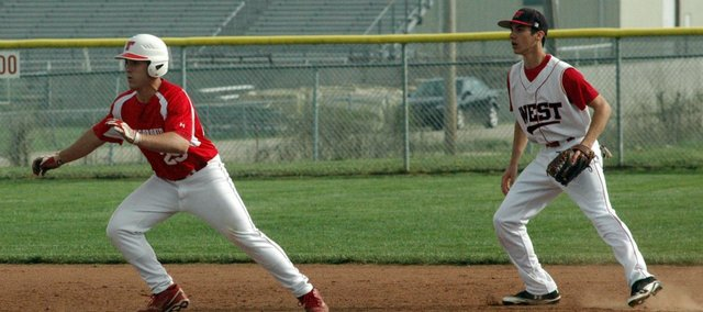 Chieftain sophomore Shane Levy, left, had four hits and five RBI in Tuesday's doubleheader against Jeff West.
