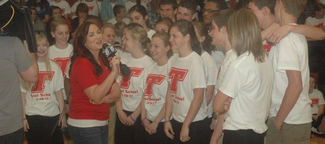 Students are interviewed during the early morning Friday, March 30, 2012. THS was selected as Wendy's Cool School on KCTV5.