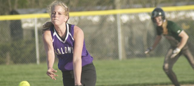 Junior Katie Pattrick throws a strike in Thursday's game against De Soto. Pattrick won both games of Baldwin's sweep Tuesday of Ottawa.