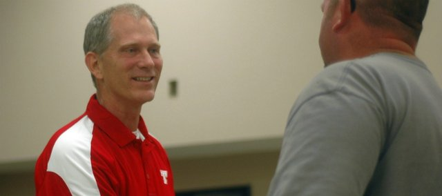 Al Troyer was introduced as Tonganoxie High's new head football coach Monday at a community meet-and-greet in the THS Chieftain Room.