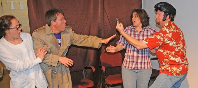Kaile Harris as Dr. Laura Turnbull and Joe Bathke as Detective Horace Scope, on the left, confront Shelly Todd as Gemini Schwarz and Doug Cheek as Taurus Zodiak in a scene from the Baldwin City Community Theatres production of Murder in the Lumberyard. The mystery spoof will be presented at 7:30 p.m. Friday and Saturday at the Lumberyard Arts Center, 718 High St.