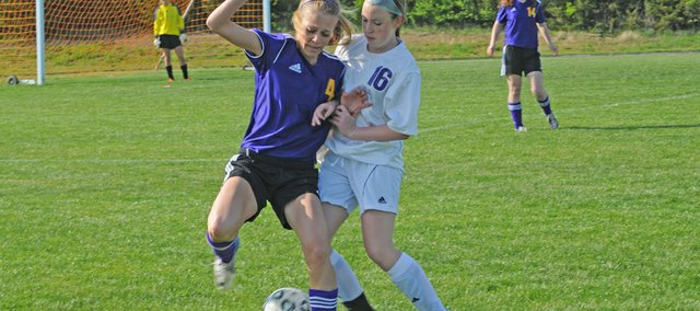 Baldwin freshman Sierra McKinney, 16, battles for the ball in Tuesday's match against Spring Hill.