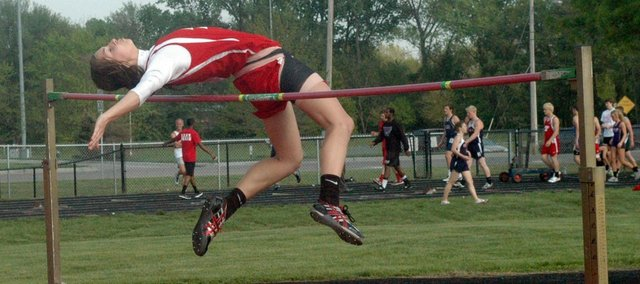 Junior Jenny Whitledge escalates in the high jump. Whitledge broke an 18-year-old school record with a jump of 5-06.25.