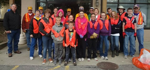 Participants in the Basehor PRIDE 2012 city-wide cleanup gather in front of the Basehor VFW Post on Saturday, April 21.