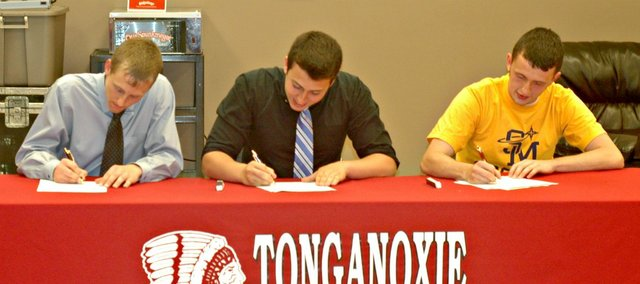 Tonganoxie High seniors Matt Briggs, left, Matt Swaim, center, and Tyler Bartholomew have signed letters of intent to play college soccer.