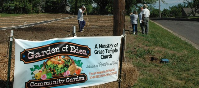 This sign advertises Grace Temple Church&#39;s garden to the community. Divided into 10- by 15-foot plots, anyone may &quot;rent&quot; a plot for $25, or $40 for two plots.