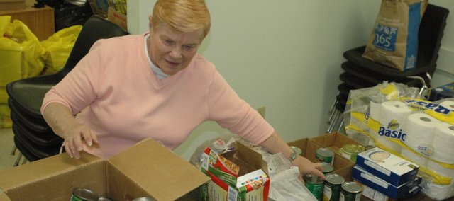Carol Geary sorts through items for the food pantry at Vaughn-Trent Community Services. Geary will retire next week after more than 10 years as the organization's director.