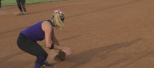 Hayley Swartz digs out a low ball at first base Thursday at Eudora. The Bulldogs have scored 70 runs during a six-game winning streak.