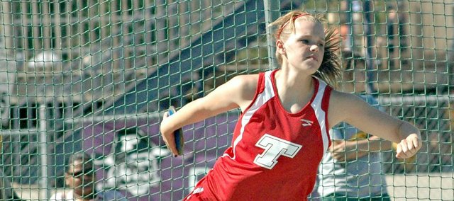 Holley Thompson spins and throws in the discus.