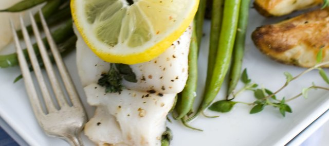 Steaming fish, such as this filet of hake, is a speedy cooking method that doesn't require added fat and doesn't deplete nutritional value. Try serving the fish over seasoned green beans with fresh herbs and lemon.