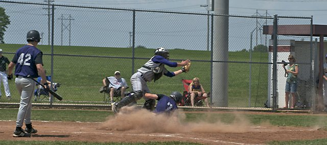 Chad Berg slides home safely Monday in the fifth inning of Baldwin's first-round regional game against Spring Hill as the Bulldogs executed a double steal. Baldwin's season ended with the 5-4 loss to the region's top-seeded Broncos.