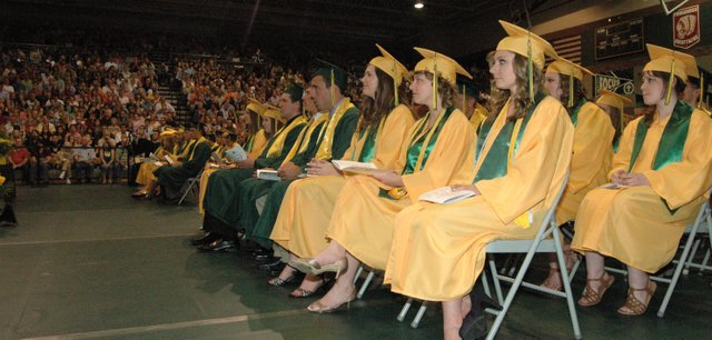 Members of the Basehor-Linwood High School Class of 2012 watch as their commencement ceremony begins in the BLHS gym May 17.