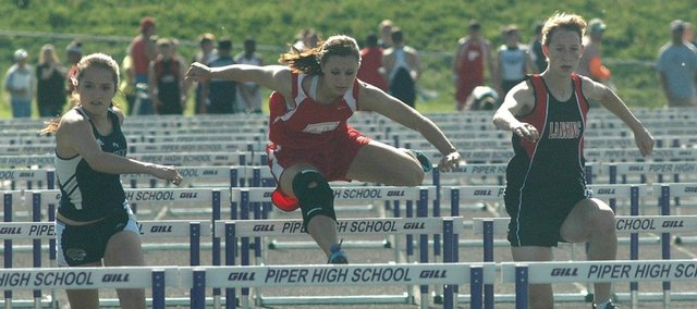 Tonganoxie High junior Hannah Kemp, center, is one of several local track athletes out to qualify for state.