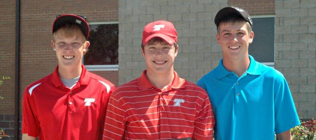 This year's THS golf seniors led the Chieftains to their first-ever regional title, but now have set their sights on a state championship. Pictured, from left, are Kody Campbell, Colby Yates and Tanner Hale.