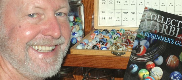 A fascination with marbles led to Shawnee resident Richard Maxwells collection and his new book.