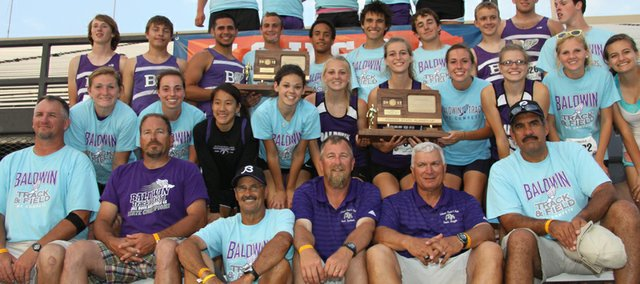 Coaches and members of the Baldwin High School boys and girls track and field teams pose Saturday in Wichita with the second-place trophies both teams won at the state meet.