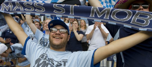 Jonas Nordman, Lawrence, cheers during the Sporting KC match against Montreal on May 5 in Kansas City, Kan. Nordman is a member of the Mass Street Mob, a rabid and rowdy group of Lawrence-based Sporting supporters.