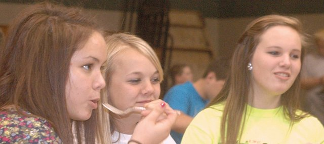 Basehor-Linwood High School freshmen Ally Nahrebeski, Raeney Seaton and Abbey Mellies eat lunch May 17 in the school's small cafeteria.