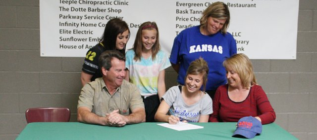 Basehor-Linwood senior Olivia Cowan was joined by family and her softball coach Susan Mayberry as she signed a letter of intent to join the Kansas University rowing team on a scholarship this fall.