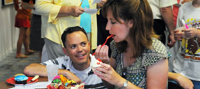 Kevin and Shawna Garber judge the cupcake contest at the July Art Walk last year. The cupcake contest will return Friday for the season's first Art Walk, which will coincide with the reopening of the Lumberyard Arts Center.